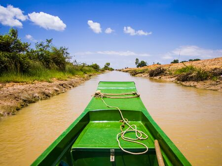 Exploring Tonle Sap lake and its channels with typical long tail boat, Siem Reap Province, Cambodia Archivio Fotografico