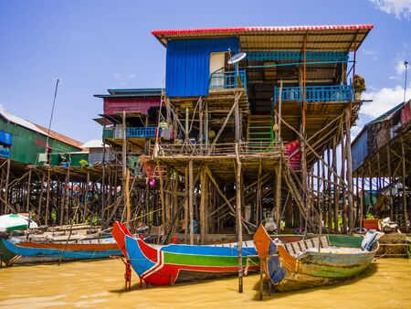 Traditional Kampong Phluk floating village with multicolored boats and stilt houses, Tonle Sap lake, Siem Reap Province, Cambodia Editoriali