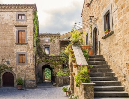 Idyllic inner alley of Civita di Bagnoregio, ghost mediaeval town built above a plateau of friable volcanic tuff, Lazio, central Italy