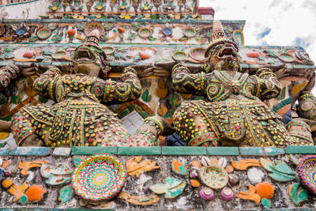 Stunning view of demon guardians supporting Wat Arun Temple, Bangkok, Thailand