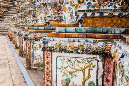 Detail of Wat Arun temple decorated with colorful tiles and floral patterns, Bangkok, Thailand Reklamní fotografie