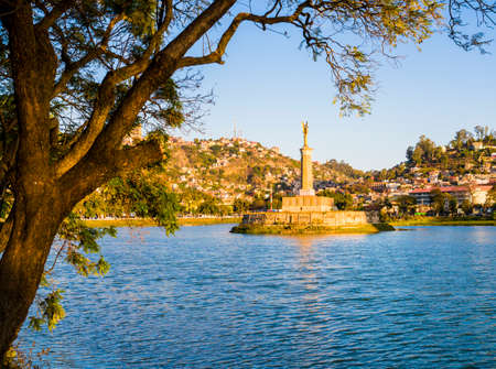 Stunning view of lake Anosy and its Monument aux Mort, a french-built memorial to those fallen in the first world war, Antananarivo, Madagascar