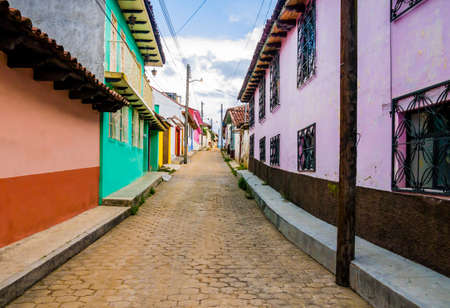 Colorful road with traditional houses in colonial style in San Cristobal de las Casas, Chiapas, Mexico