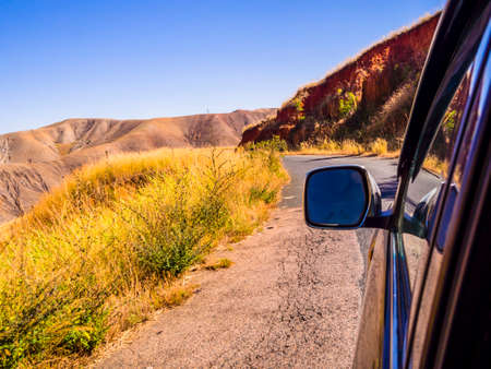 Driving a car through the scenic landscapes of Madagascar highlands