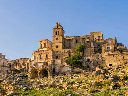 Stunning view of Craco ruins, ghost town abandoned after a landslide, Basilicata region, southern Italy
