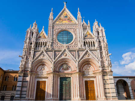 Stunning view of Siena Cathedral main facade, a medieval church now dedicated to catholic Assumption of Mary, Tuscany, Italy