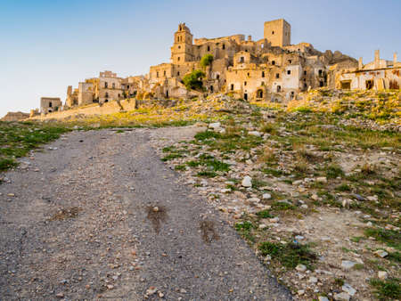 Dramatic view of Craco ruins, ghost town abandoned towards the end of the 20th century due to natural disaster, Basilicata region, southern Italy Redakční