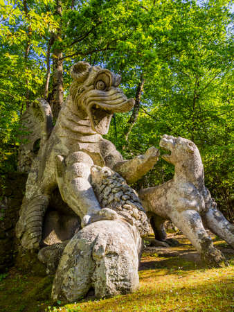 Winging dragon fighting against three beasts, a huge sculpture at famous Park of the Monsters, also named Sacred Grove, Bomarzo Gardens, province of Viterbo, Lazio, Italy Reklamní fotografie