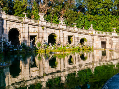 Stunning view of Eolo fountain with arches and marble statues, Royal Palace of Caserta, Italy