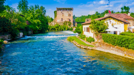 Stunning view of Borghetto historical center and Visconti bridge, Valeggio sul Mincio, Italy Reklamní fotografie