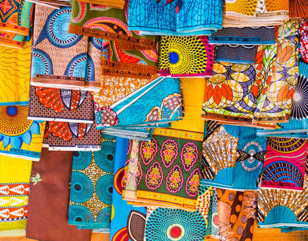 Display of multicolored ethnic pareo with floral and geometric shapes, Antananarivo market, Madagascar Reklamní fotografie