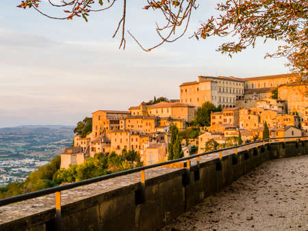 Panoramic view of the historic center of Todi during the autumn season, typical mediaeval village over Umbrian valley, central Italy