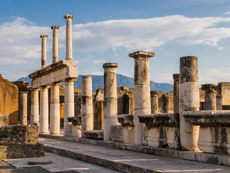 Evocative ruins of the ancient city of Pompeii with columns and capitals, Naples, Italy