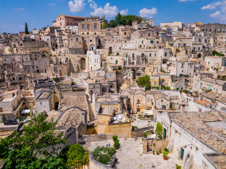 Stunning view of Sasso Barisano district and its characteristic cave dwellings in the ancient town of Matera, Basilicata region, southern Italy