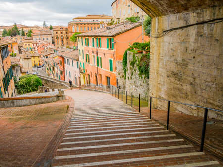 Perugia, picturesque view of the medieval aqueduct, pedestrian street surrounded by colorful houses, Umbria region, central Italy