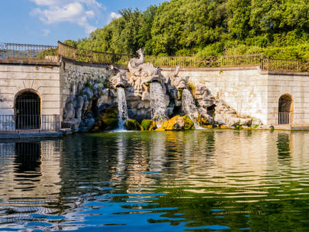 Stunning view of the three dolphins fountain, Royal Palace of Caserta, Italy
