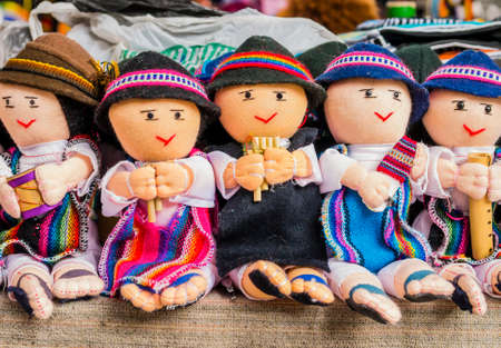 Row of male rag dolls in traditional clothes playing musical instruments, Otavalo Market, Ecuador Reklamní fotografie