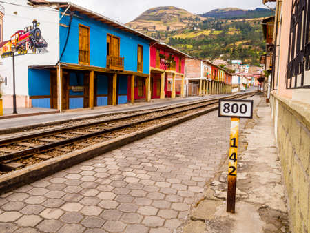 Stunning row of typical colorful houses in Alausi railway station, starting-off point for Devil's Nose train in Ecuador