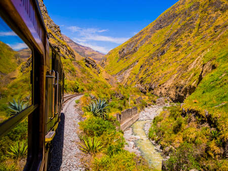 Impressive view of Devil's Nose train running on beautiful andean landscape, Alausi, Ecuador