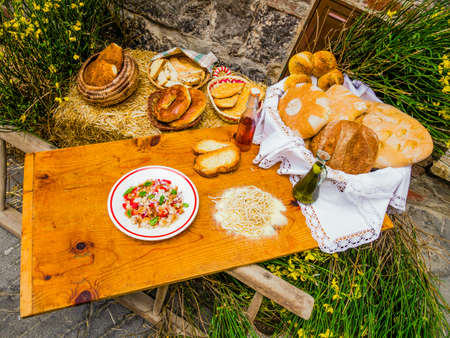 Rustic wooden board full of typical tuscan food, italian countryside