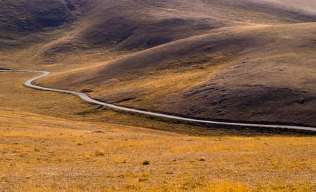 Dream road through Campo Imperatore valley, Gran Sasso National Park, Abruzzo region, Italy