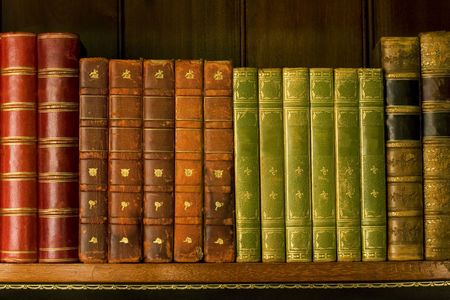 OLD LIBRARY: Old hardcover books on bookshelf Stock Photo