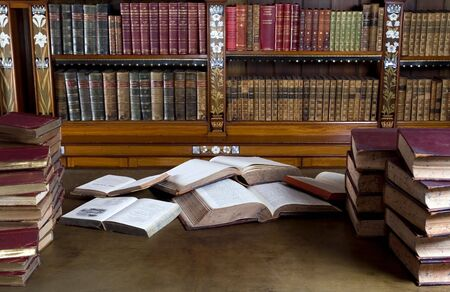 untidiness: Old reading room with mess on the desk Stock Photo