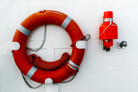 Lifebuoy is fixed on hull of a ship. Front view.