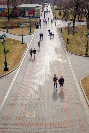 People walking in the Alexandrovsky Garden in the city of Moscow, Russia - 17 March, 2017. View from above.