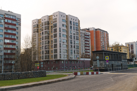 View of residential buildings in a modern city. Near the entrance to the subway.