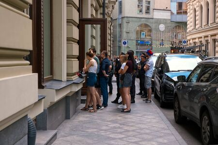 Russia, Moscow, July 1, 2018. FIFA World Cup 2018 fans watch the Russian-Spain football match through a window of a street cafe on Nikitskaya Street