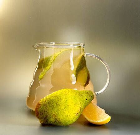 pear tea in a glass teapot winter warming drink Banque d'images