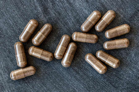 close-up of licorice (DGL) capsules. dietary concept. dietary supplement topview.