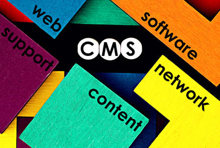 """Photo on CMS (content management system) theme. The abbreviation """"CMS"""" on a colorful background. Technology concept image"""
