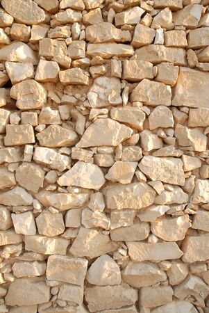 background texture with yellow stones close sand