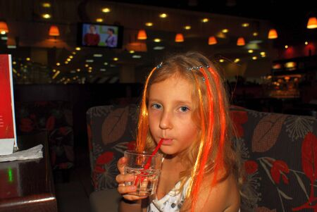 girl child drinks a cocktail