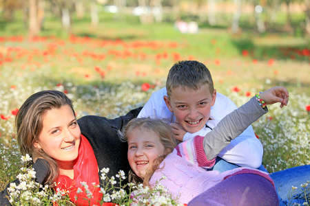 douther: Mom with son and daughter in the park fooled spring Stock Photo