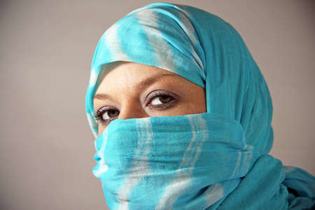 Arab woman in a veil looks photo