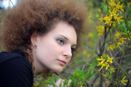 portrait of a girl in nature with yellow flowers Stock Photo - 13372090