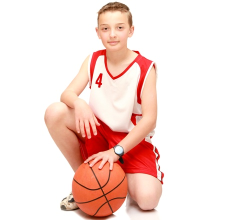 Boy athlete with the ball on the isolated Stock Photo