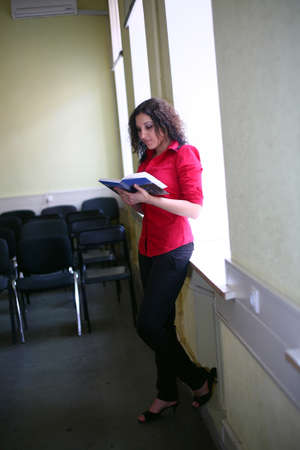 Brunette student with a book photo