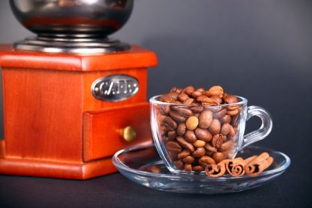 vintage coffee grinder with a cup of beans photo