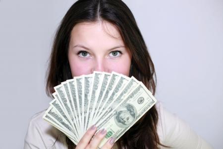 brunette girl with money photo