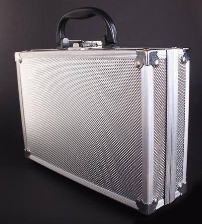 steel case on a dark  background photo
