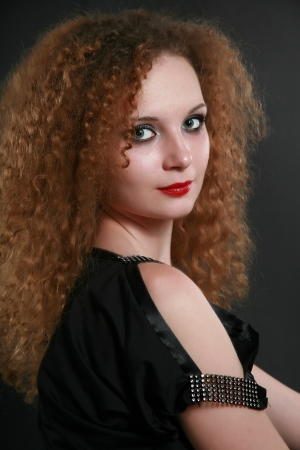 Portrait of girl curls in dark background photo