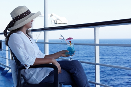Woman relaxing during a cruise on a summer day