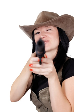 girl in a cowboy hat with a gun isolated photo