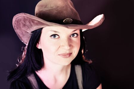 portrait of a cowgirl in a hat photo