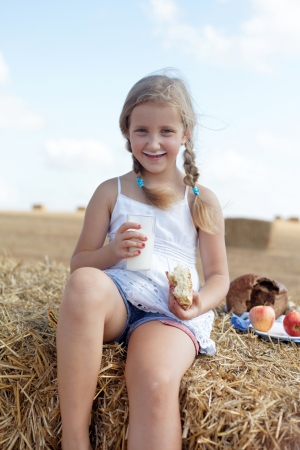 agri: cute young girl dines on clean air Stock Photo