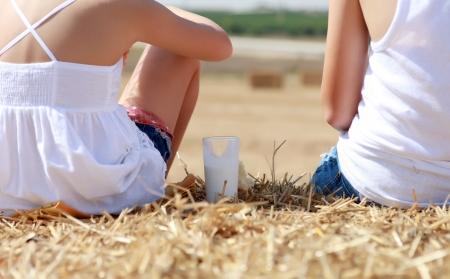 people sitting on hay to clean air